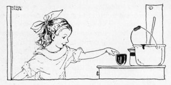 little girl pointing to a cup